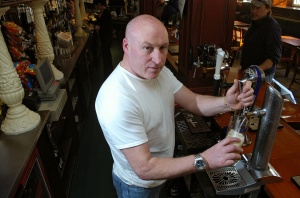Peter Swanson behind his bar in Edinburgh