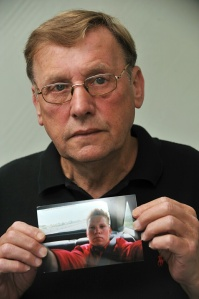 Bernard Boylan with a picture of his son John